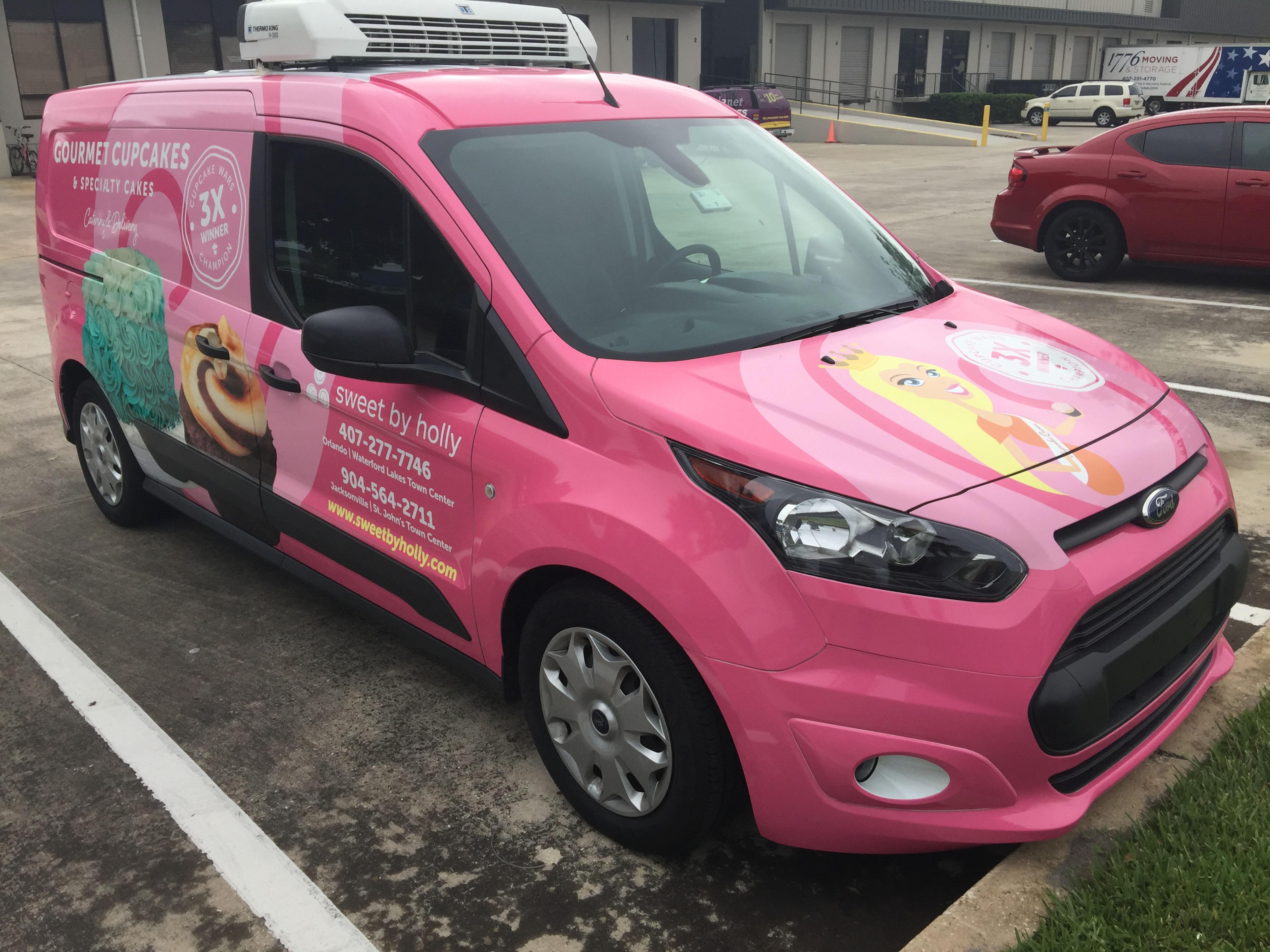 Sponsorship marketing used on van for gourmet cupcakes